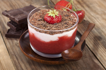 Strawberry smoothie with yogurt and grated chocolate.