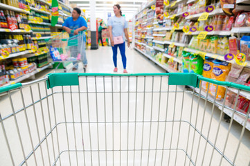 Abstract blurred photo of store with trolley in Supermarket stor
