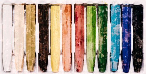 Oil Crayons with Bright Colors close up on a decorate paper shee