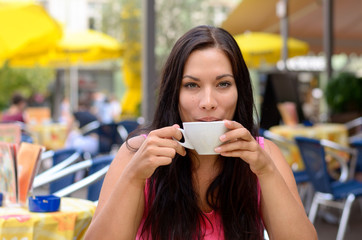 Gorgeous woman sipping coffee