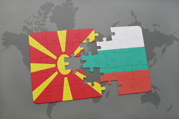puzzle with the national flag of macedonia and bulgaria on a world map background.