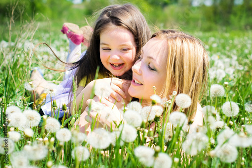 Happy Family takes Fun on Flowers Meadow in Summer - Healthy Lifestyle