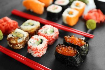 Sushi set and chopsticks on slate plate