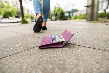 Close-up Of Woman Losing His Wallet