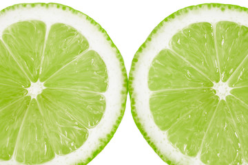 Fresh cut lime fruit isolated on white background - close up image.