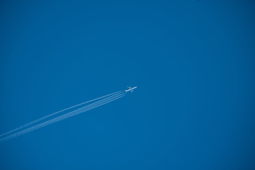 Shot of a jet plane high in the blue sky