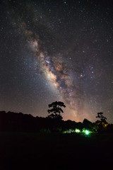 milky way and silhouette of Tree with cloud. Long exposure photo