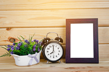 Blank wood photo frame and alarm clock.