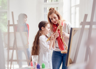Art Lesson. little girl and woman