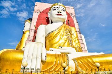 Sitting Golden Buddha Statues at Kyaik Pun Paya in Bago