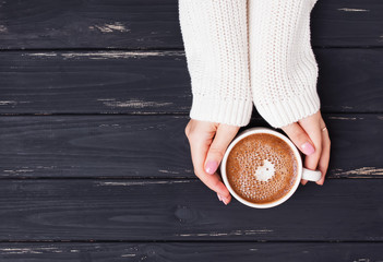 Fotobehang - Woman's hands holding cup with coffee