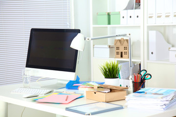 Designer working desk with computer and paperwork