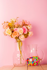 Colorful Modern Living room with vase of color roses and pink pa
