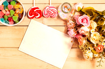 Colorful roses flowers and empty tag for your text with sweet Je