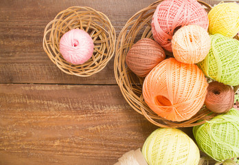 Balls of colorful yarn for crochet. Sample knit. On wooden background.
