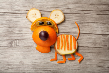 Funny orange tiger made on wooden background