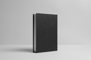 Black Hardcover Book Mock-Up - Backside. Wall Background