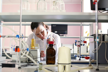 Girl chemist working in a chemical laboratory