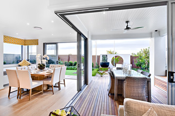 Modern dining room attached to outside patio area