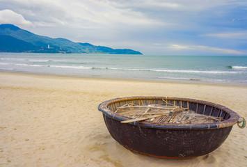 Mountains and Bamboo boat at China Beach Danang in Vietnam