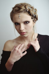 girl in medieval style. jewels in her hair.