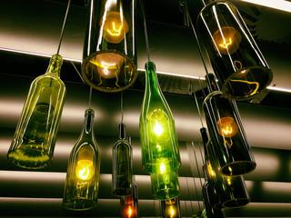 Beautiful retro light lamps decor made of wine bottles