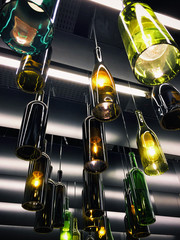 Magnificent retro light lamp decoration made of empty wine bottles