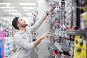 man customer in hardware store