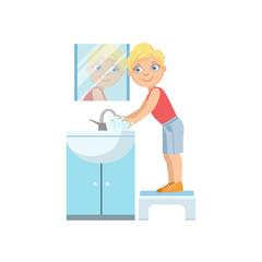 Boy Washing Hands In Bathroom Tap