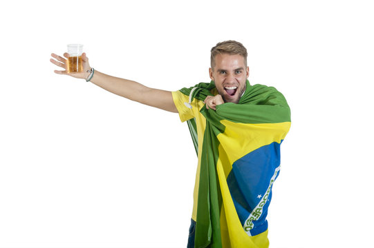 Young Brazilian Supporter with a Brazilian flag in Support