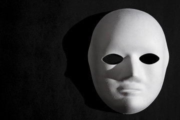 White Venetian mask and black background