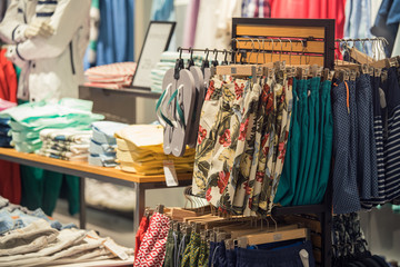 Clothing Store Interior With Summer Clothes On Foreground