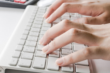 Woman typing on computer keyboard can be used for e-commerce, business, technology and internet concept, Vintage tone filter
