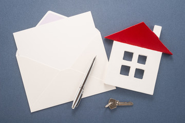 Envelope, pen, key and house