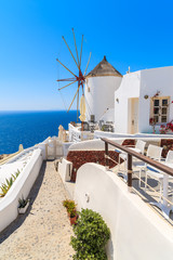 View of famous windmill in Oia village, Santorini island, Greece