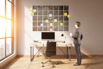 Businessman looking at calendar