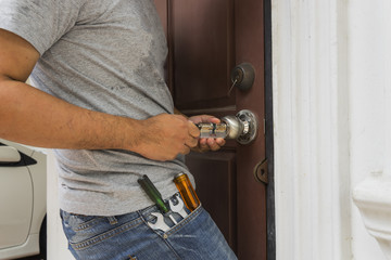 locksmith try to open the door with key maker tool - can use to display or montage on products