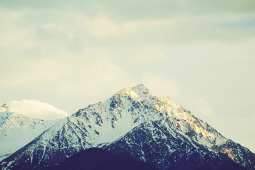 Winter mountains with clouds hipster vintage filter