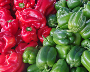 Background of red and green bell peppers.