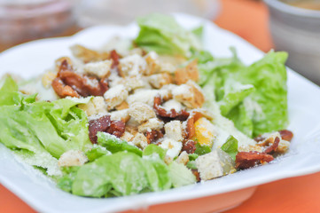 caesar salad or vegetable salad with bacon