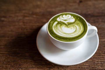 matcha green tea latte on a wooden table