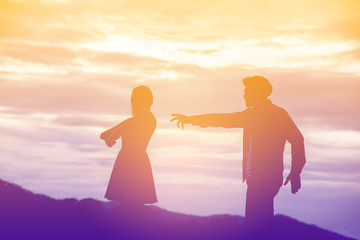 Silhouette of a angry woman and man on each other