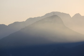 Beautiful blue mountains in the fog. Coast of Salerno, Italy.
