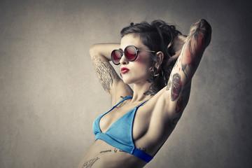 Tattooed woman wearing a swimsuit