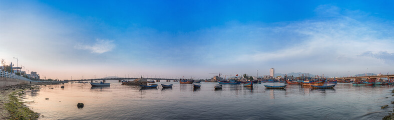 Vietnam, Nha Trang. May 3, 2015. Panorama. Fishing village early in the morning. Ships and boats. Bridges over the river Cai.