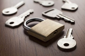 Keys and lock on wooden background, Security concept