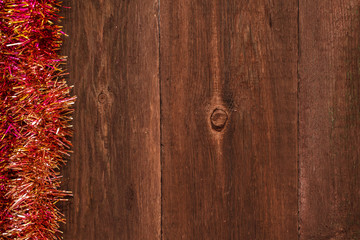 Christmas tinsel on a wooden background