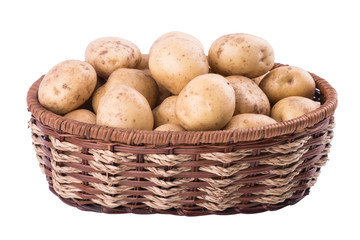 Raw potatoes in basket on white background.