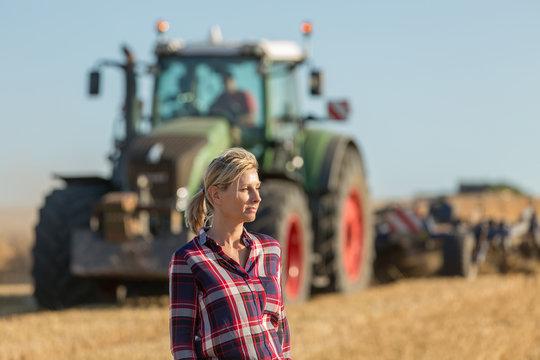 female farmer standing in wheat field