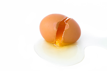 Broken egg on white background, food concept